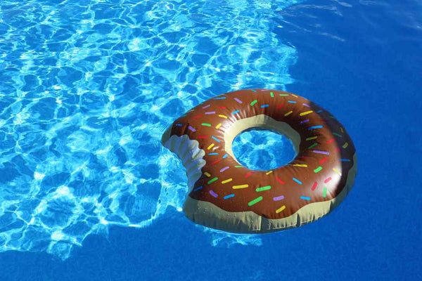 Swimming pool water with donut inflatable.