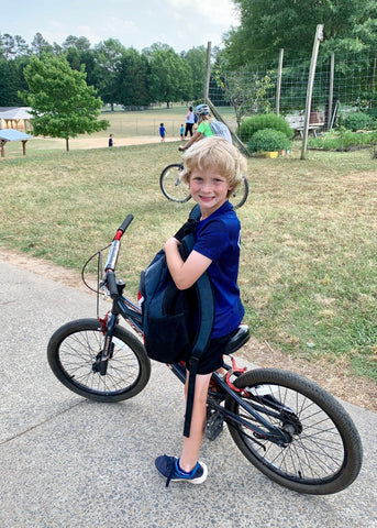 boy on bike at school