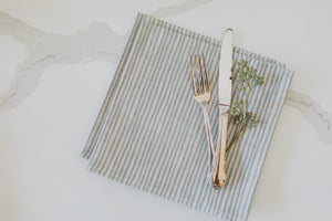 Briton Home offers luxury linen napkins in Blue Stripe from Sam Wilson