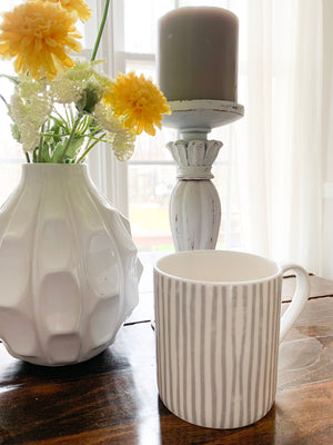 Briton Home offers this pretty grey and white striped mug for coffee or tea, by Sam Wilson