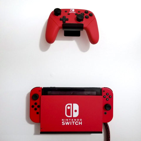 Nintendo Switch and controller wall mounted in HIDEit Uni-C and HIDEit Switch Wall Mount