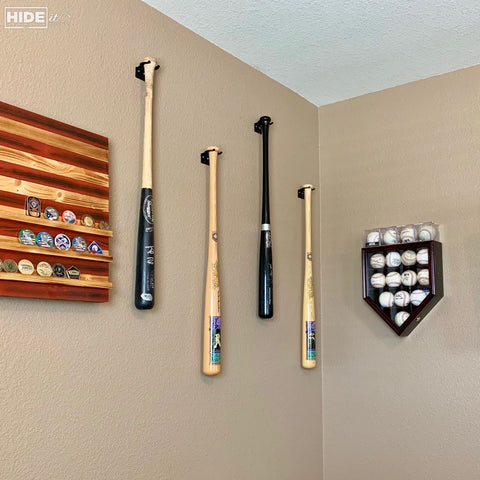 HIDEit VBat Baseball Bat Mount hanging in a room.