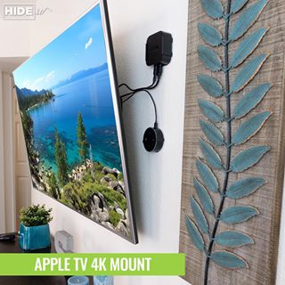 Apple TV and Echo wall mounted behind wall-mounted TV using HIDEit Mounts custom wall mounts