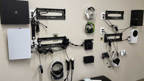 HIDEit HQ Gamer Wall. Cords with cord wraps and hiding cables behind the TVs