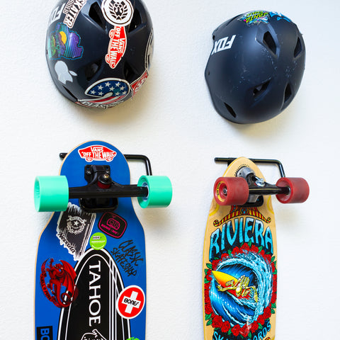 Two skateboards displayed on wall showing off their decks in HIDEit Display Skate Mounts.
