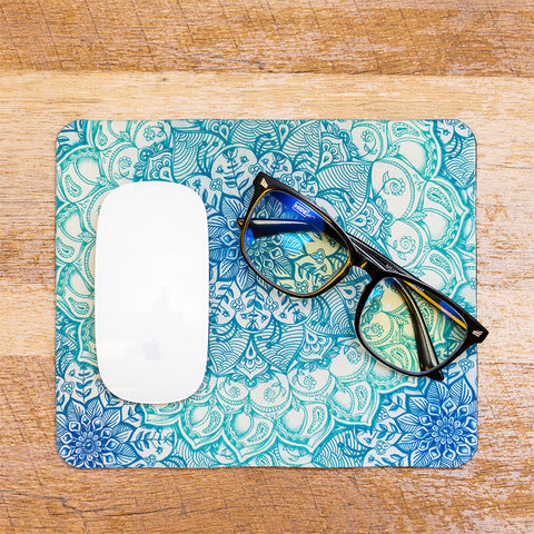 HIDEit blue light blocking gaming glasses folded closed and sitting on mouse pad