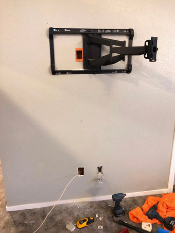 TV wall mount on wall without TV, power outlet box and cables
