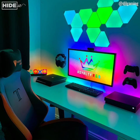 Gaming desk with LED light strips and HIDEit Gaming Mounts.