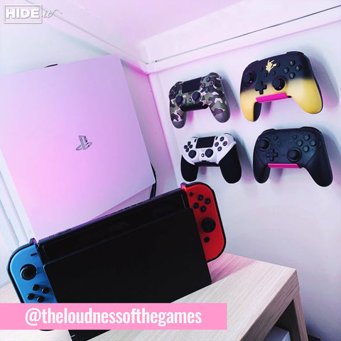 HIDEit Pink Uni-C controller mounts with Playstation controllers and Playstation wall mount