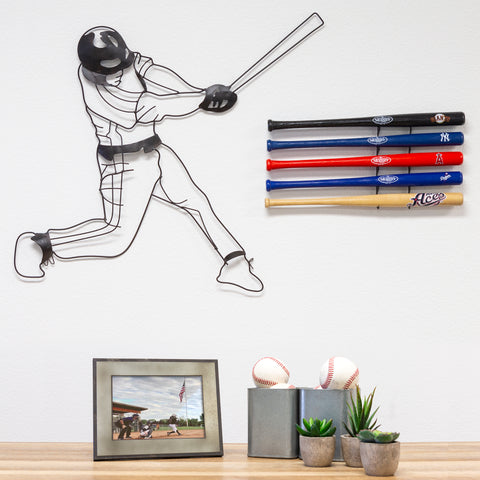 Mini bats wall mounted in a sports room using a HIDEit Mini Bat Wall Mount.