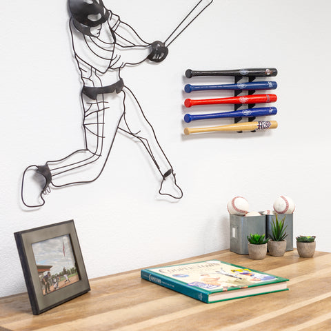 HIDEit Mini Baseball Bat Mount hanging in a room with baseball bats.