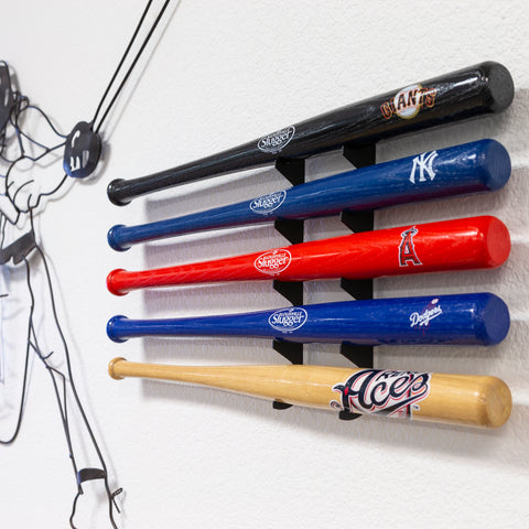 Close up of 5 mini bats wall mounted in a HIDEit Mini Bat Mount.