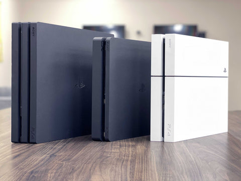 PlayStation 4 family of consoles standing