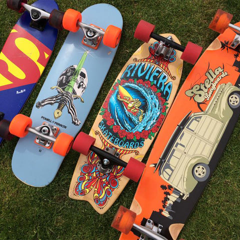 Four complete skateboards, including a Riviera Skateboard and Stella Longboard