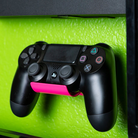 Pink HIDEit Universal Controller wall mount with black PlayStation controller