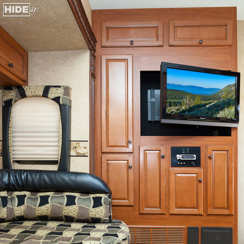 HIDEit Uni-M Wall Mount used in RV to hide cable box behind mounted TV.