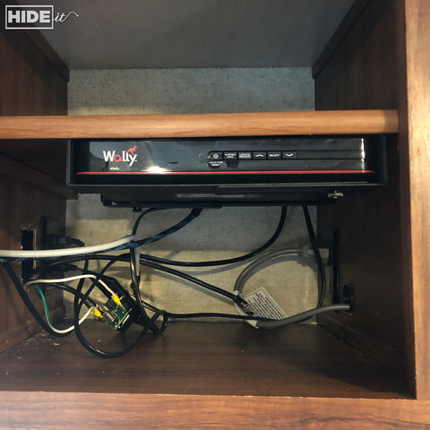 HIDEit Mounts under-shelf storage solution for cable box in RV.