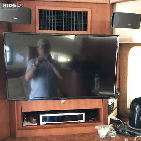 HIDEit Mounts hide it all behind the TV in your RV or yacht.