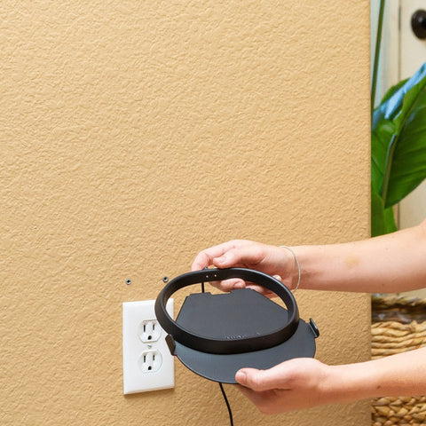 Move's charging base securely slides into the HIDEit Move Speaker Mount.