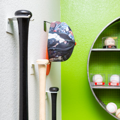 Three baseball bats wall mounted with white HIDEit VBat Mounts