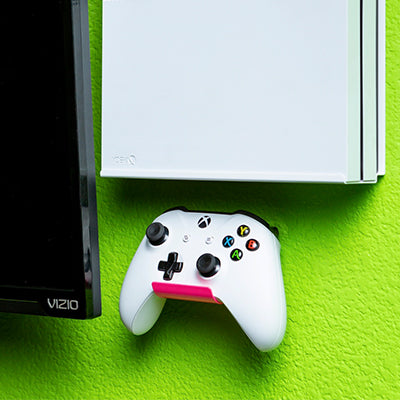 HIDEit Pink Uni-C Controller Wall Mount with Xbox controller.