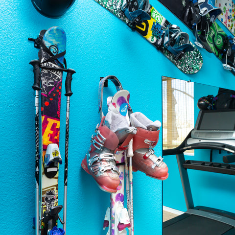HIDEit Vertical Ski Wall Mount with skis and poles mounted.