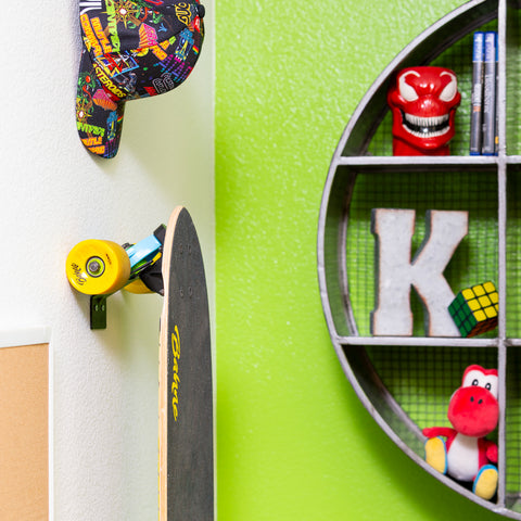 HIDEit Vertical Skateboard Mount sleekly displaying a cruiser board on the wall.