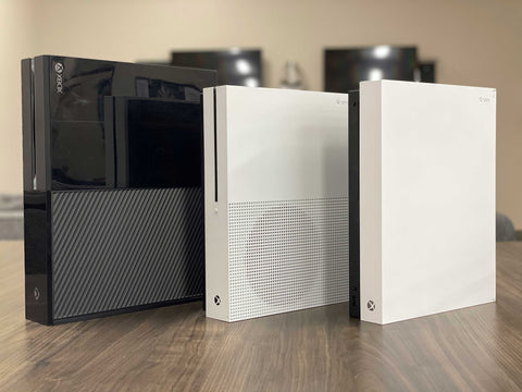Xbox One famiily of consoles standing