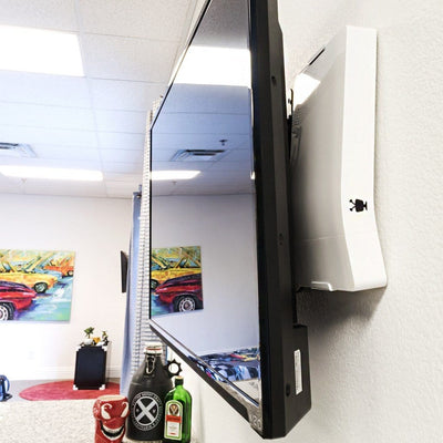 TiVo Bolt mounted behind wall mounted TV