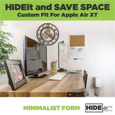 Apple AirPort Extreme wall mounted in HIDEit Air-XT next to a desk in a workspace.
