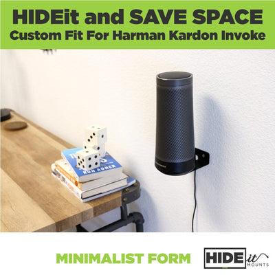 Harman Kardon Invoke Speaker mounted next to a desk in a wall mount designed for the Invoke Harman Kardon.
