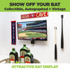 Two collectible baseball bats securely held in single vertical bat mounts next to a wall mounted TV in a man cave.