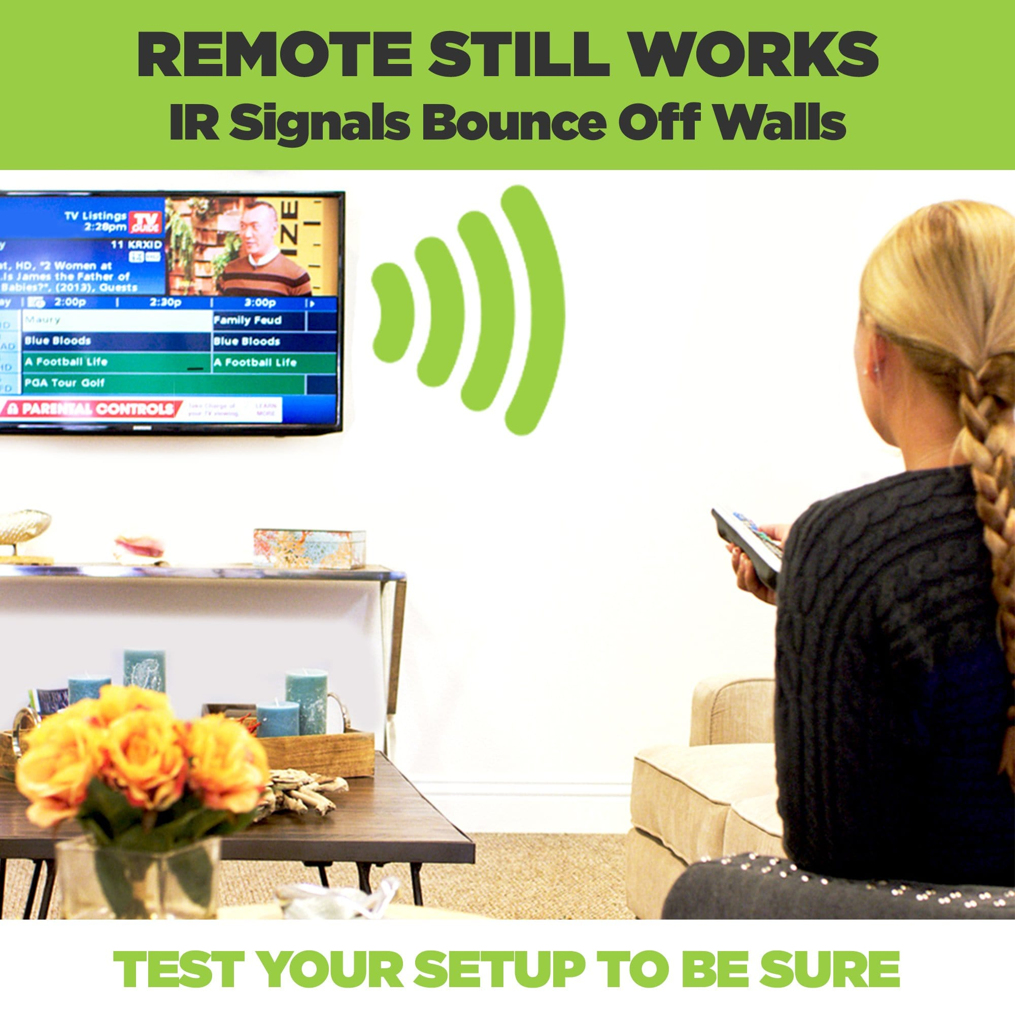 Small electronic device mounted behind the TV in a HIDEit wall mount.