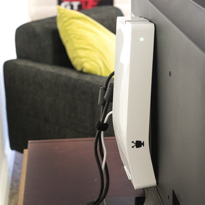 TiVo Bolt Mounted on the back of a TV using a HIDEit Mount