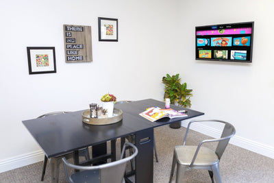 Clean Dining Room setup with TV showing no cords thanks to HIDEit Mounts