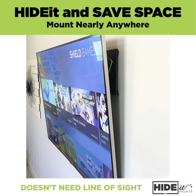NVIDIA Shield mounted to the wall behind the TV in the HIDEit Shield mount.
