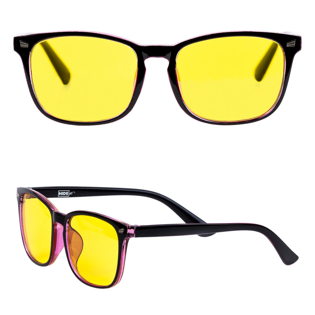Pink and black HIDEit gaming glasses with yellow lenses for added protection from blue light.
