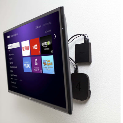 Wall mounted TV with Fire TV and Roku 4 wall mounted behind