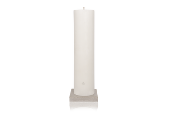 MAJO RUMI 1 metre tall white giant outdoor garden pillar candle with grey MAJO logo, standing on grey polished concrete base