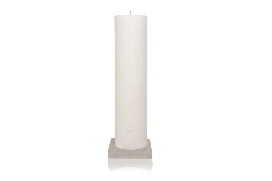 MAJO RUMI 1 metre tall white outdoor pillar candle with grey MAJO logo, standing on grey polished concrete base