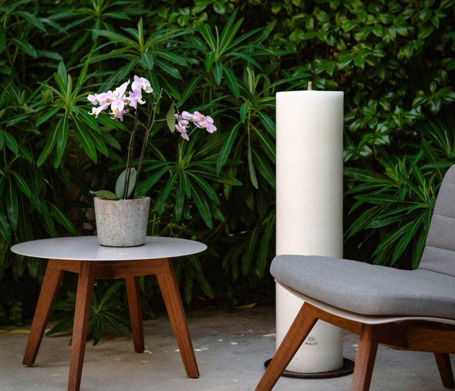 MAJO outdoor candle 1 metre tall in garden with garden furniture