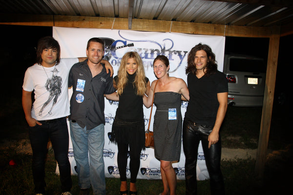 Ryan and his wife Lynn with The Band Perry