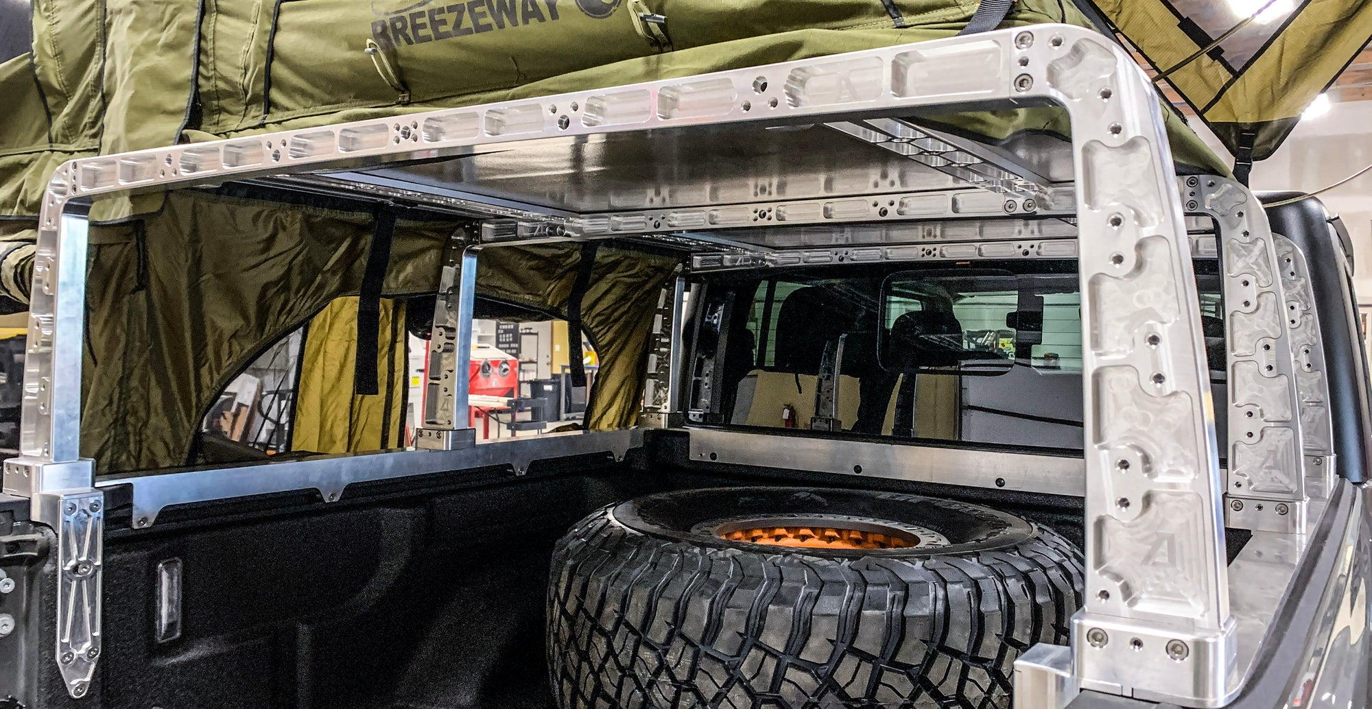 Outlander Gladiator Truck Bed Rack System from rear upright crossbeams and stringer bed cap