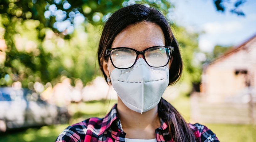 Women wearing a mask which is fogging up her glasses