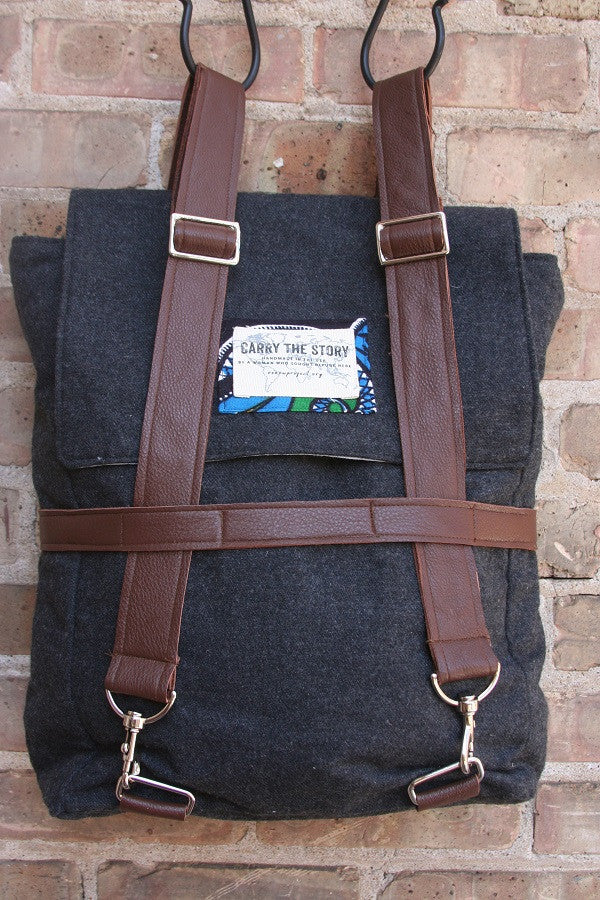 gray wool backpack with brown leather handles