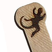 Gecko burned into wooden scoop. Lizard