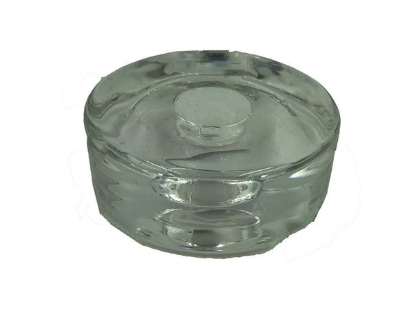 Round clear glass ritual candle holder about size of quarter