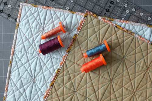Aurifil threads used for wholecloth quilt tutorial on how to domestic machine quilt six pointed star quilting