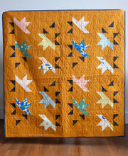 Load image into Gallery viewer, The Weekend Quilter Sample Sale Solar Slice Baby Size Quilt in Ruby Star Society Brown Rust