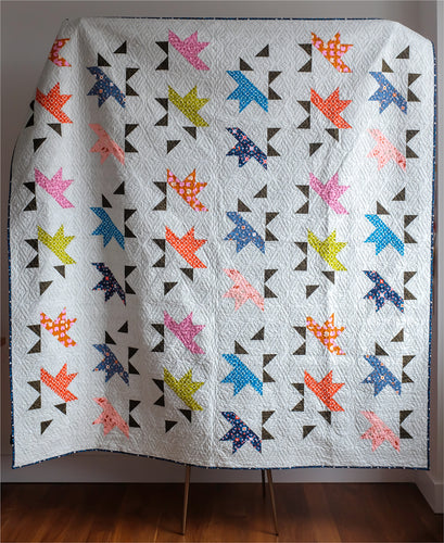 The Weekend Quilter Sample Sale Solar Slice Throw Size Quilt in Ruby Star Society Grey